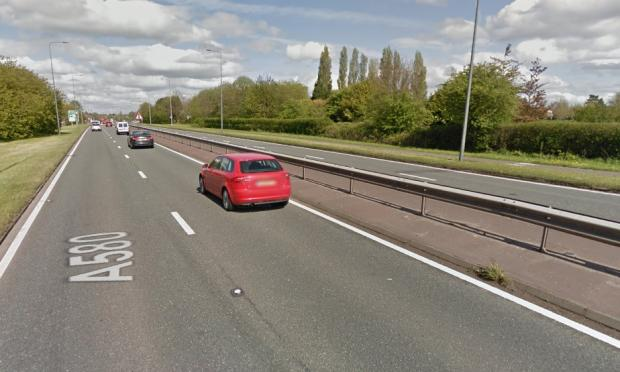 Car fire on East Lancs Road causes delays for drivers